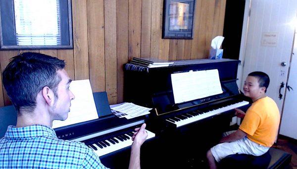 giving piano lesson