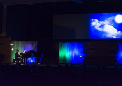 Music Alive student playing piano with multimedia