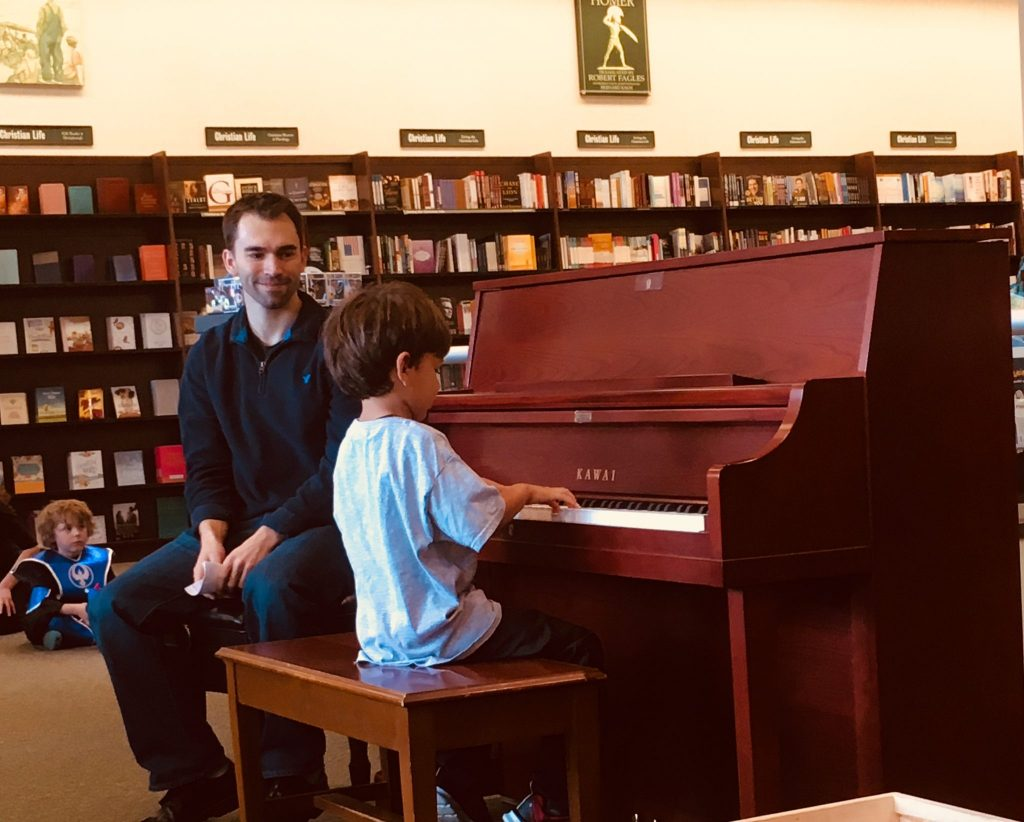 young student playing piano